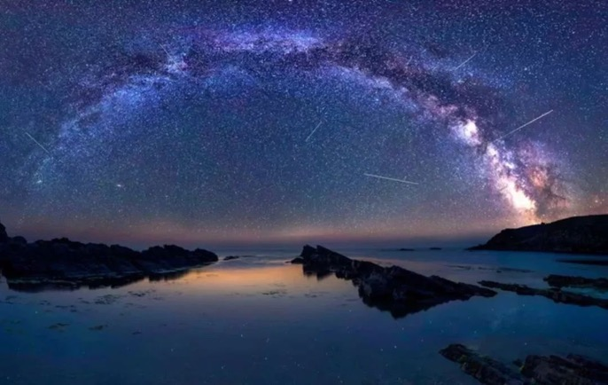 A picture containing water, outdoor, nature, night sky  Description automatically generated
